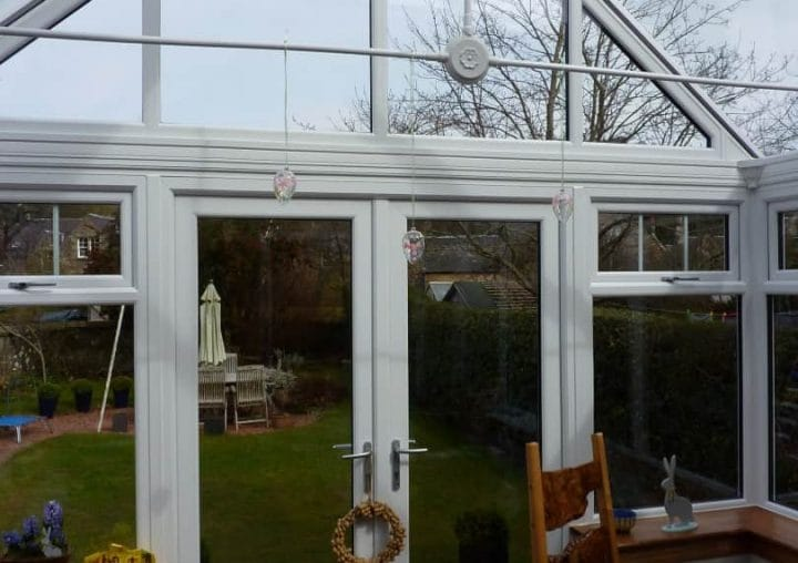 White conservatory with garden