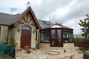 Brown conservatory with pitched roof - SRJ Windows