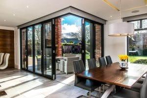 Bi-folding doors in house kitchen - SRJ Windows
