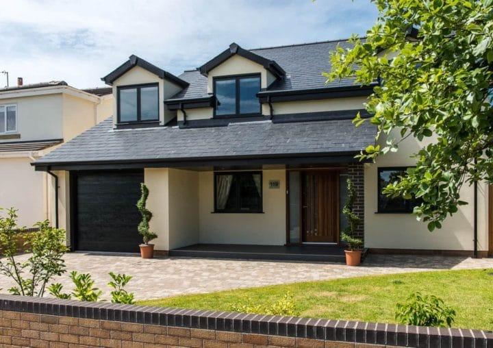 Modern home with composite door and casement windows