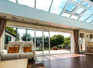 Living room with glass roof and sliding doors