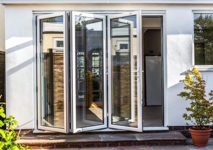 Slim bi-folding white doors