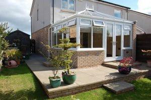 White Conservatory Sun Room with Tilt & Turn top windows - SRJ Windows