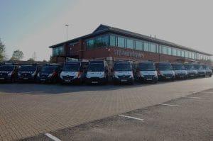 SRJ Windows showroom and vans parked outside