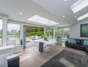 Beautiful White Sunroom with Bi-Fold Doors - SRJ Windows